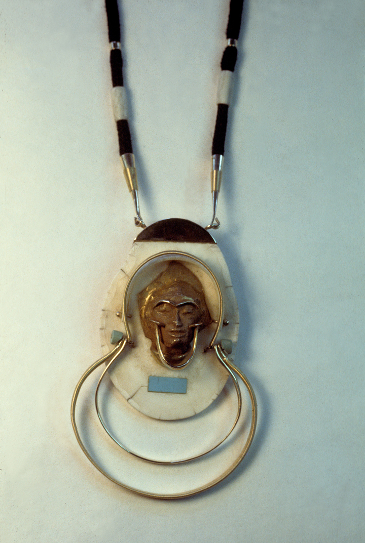 Toza, pendant, gold and ivory with black cord, 1980s
