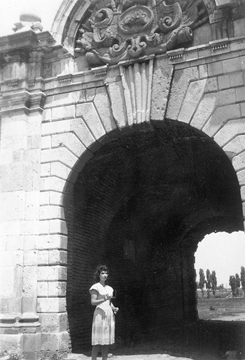 Ruth in an archway in Europe, c. 1940s
