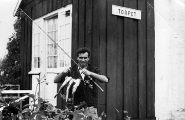 Svetozar holding a fish, in Torpet, Denmark, early 1950s