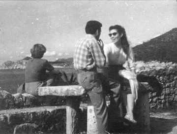 Ruth and Svetozar sitting on a sea wall in Europe, early 1950s